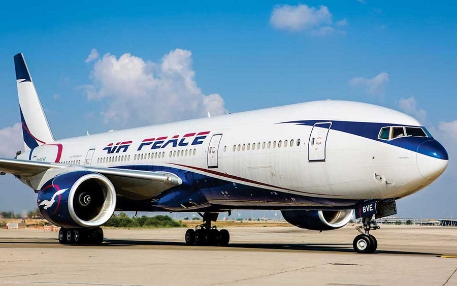 TRENDING VIDEO: Frustrated passengers aboard Air Peace plane fan themselves profusely with paper